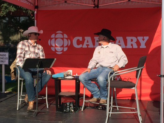 David Gray, host of the Eyeopener on CBC Radio (L) interviewing Codey McCurrach, chuckwagon driver (R) at the CBC Breakfast