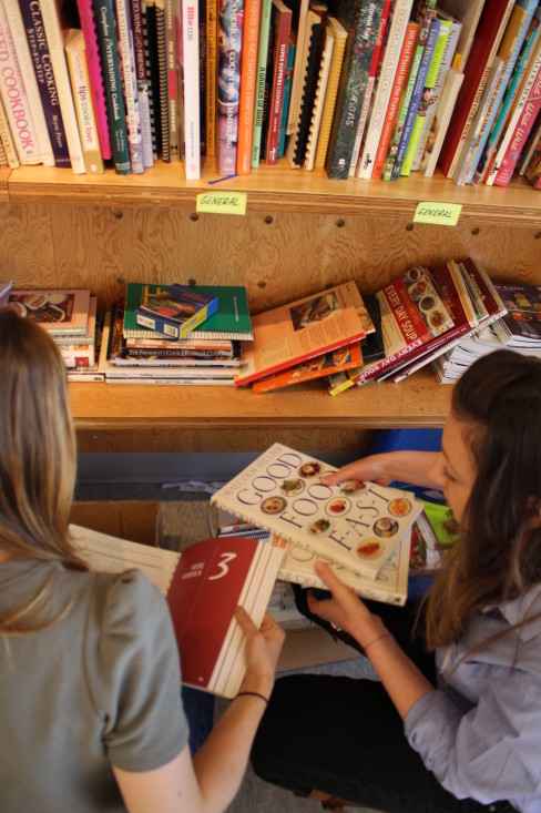 Two Stampede team members helped organize the community library of health-focused books.