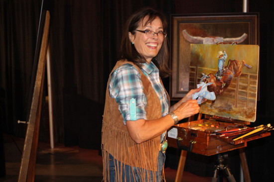 Darcy Presiloski doing a live-demo of her art at the Canvas Auction.