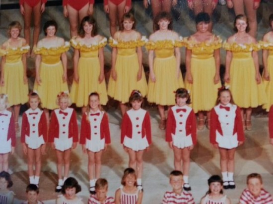 Kerrie Everitt (second from right in red and white) in the 1985 Grandstand Show.