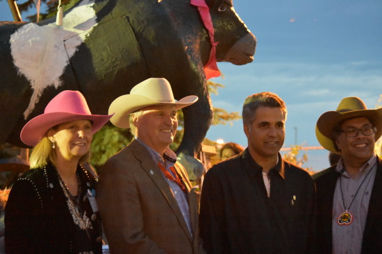 Pictured: Steacy Collyer executive director Calgary Reads, Bill Gray, president & chairman of the Calgary Stampede board of directors, Honourable Irfan Sabir, Minister of Human Services, and his worship, Mayor Naheed Nenshi