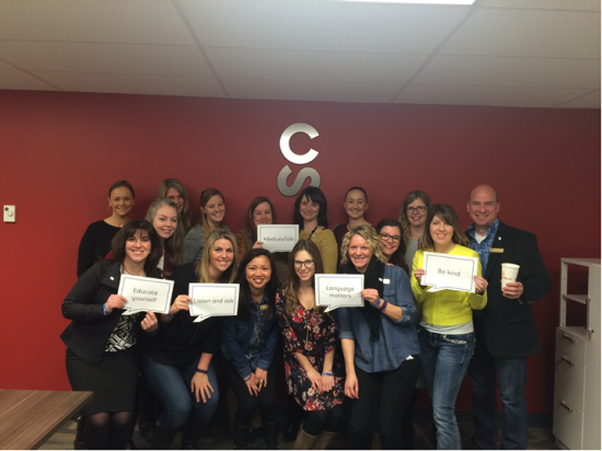 Calgary Stampede employees gather to support the #BellLetsTalk initiative.