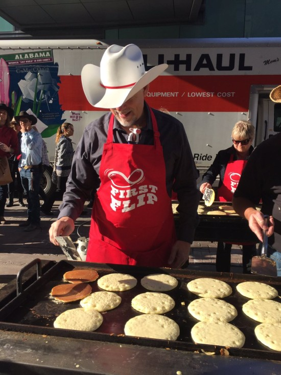 Pancakes being flipped at the First Flip breakfast hosted by Tourism Calgary