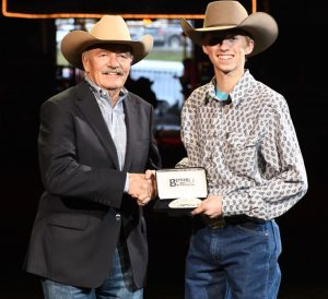 John Rule, Calgary Stampede Rodeo Committee Chair, with Canadian Steer Riding Champion Dixon Tattrie - Courtesy CFR