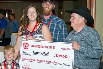 Tammy Noel and family accepting their Stampede Split 'Em 50 winnings cheque